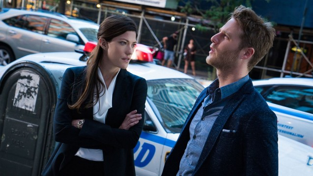"""Badge! Gun!"" -- Brian risks his new FBI job when he disobeys orders to stay out of the investigation into a renowned journalist's murder, on LIMITLESS, Tuesday, Sept. 29 (10:00-11:00 PM, ET/PT) on the CBS Television Network. Pictured (L-R) Jennifer Carpenter as Agent Rebecca Harris and Jake McDorman as Brian Finch Photo: David M. Russell/CBS ©2015 CBS Broadcasting, Inc. All Rights Reserved"